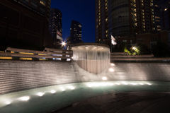City fountain at night Stock Images