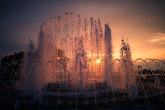 City fountain at sunset. Selective focus with shallow depth of field Royalty Free Stock Photos