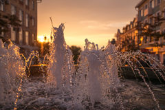 City fountain at sunset. Selective focus with shallow depth of field Stock Photography