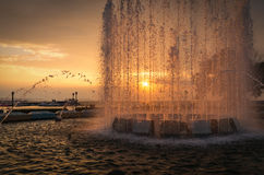 City fountain at sunset. Selective focus with shallow depth of field Stock Photo
