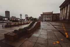 City in front of The Palace of Culture and Science. Downtown of Warsaw during heavy raining, Poland Royalty Free Stock Photo