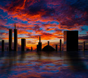 City at sunset. City skyline at sunset, dramatic clouds royalty free illustration