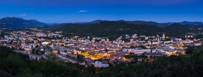 The City of Gap at twilight. Hautes-Alpes, Alps, France. Elevated panoramic view of the City of Gap at twilight. Hautes-Alpes, Southern French Alps, France stock photo