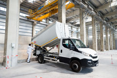 City garbage truck in waste depot Stock Photo