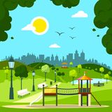 City Garden with Children`s Playground. And City Silhouette on Background. Sunny Day in Park Stock Photo