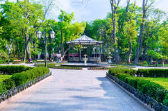 The city garden. ODESSA, UKRAINE - MAY 18, 2015: The City Garden is the central park with a lot of benches in shade, fountains and restaurants, on May 18 in royalty free stock image
