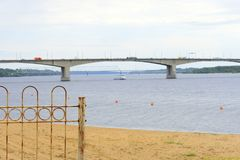 City gate beach river boat, a bridge with cars moving across the bridge. In the distance you can see the railway bridge royalty free stock image