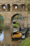 City gate the Berkelpoort, river Berkel, and boats Stock Photos
