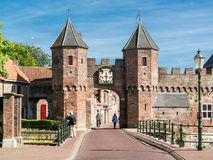 City gate Koppelpoort in Amersfoort, Netherlands. Medieval fortress city wall gate Koppelpoort and Eem River in the city of Amersfoort - tourist destination near Royalty Free Stock Photo