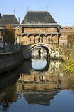 City gate Koppelpoort and river, Amersfoort. Netherlands, this city gatehouse is a combination of a land and water gateway. Through this port leaves the river Stock Photo
