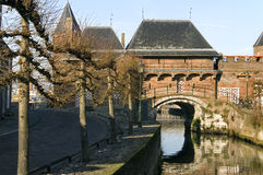 City gate Koppelpoort and river, Amersfoort. Netherlands, this city gatehouse is a combination of a land and water gateway. Through this port leaves the river Stock Photos