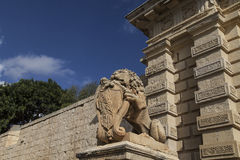 City Gate with stone lion to the medieval town Mdina, Malta. Europe Stock Image