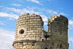 Castle Turret Arles France. Towering above the narrow streets of Arles, visitors pass by the medieval gate turret that once guarded this beautiful city Stock Images
