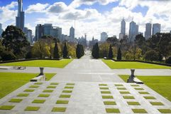 City Gateway. The park pathway leading into the heart of the city.  Memorial Gardens, Melbourne, Australia Royalty Free Stock Image