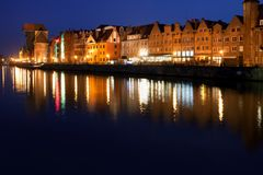 City of Gdansk Old Town Skyline at Night in Poland. City of Gdansk at night in Poland, Old Town skyline river view Stock Photo