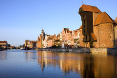 City of Gdansk in Poland. Gdansk (Danzig) Old Town waterfront along the river Motlawa in Poland at sunset, on the right side of the image The Crane (Polish Stock Photo
