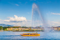 City of Geneva with famous Jet d'Eau fountain at sunset, Switzerland Royalty Free Stock Photo
