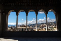 City of Genoa through the colonnade of the Saint Lawrence San Lorenzo Cathedral, Genoa, Italy royalty free stock photos