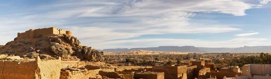City of Ghat, Akakus (Acacus) Mountains, Libya. Old City (Medina) and Fortress (Koukemen) of Ghat, Akakus (Acacus) Mountains, Sahara, Libya - Panoramic View stock photos