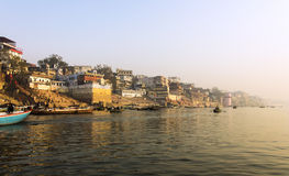The city and the ghats of Varanasi. In the early morning at sunrise. (all faces and logos blurred Stock Photo