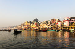 The city and the ghats of Varanasi. In the early morning at sunrise. All faces and logos blurred Royalty Free Stock Image