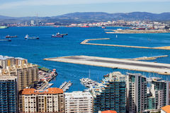 City of Gibraltar Bay and Airport Runway. Modern apartment buildings in Gibraltar, bay, airport runway, Spain on the horizon Royalty Free Stock Images