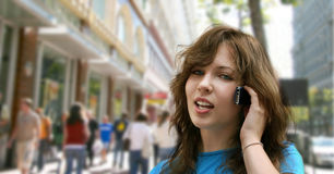 City girl. Talking on the phone Royalty Free Stock Photography