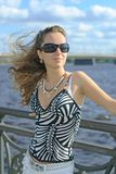 City girl. Beautiful young girl with sunglasses in the city Stock Photography