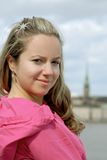 City girl. Young beautiful girl smiling with city background Royalty Free Stock Image