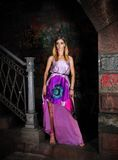 City girl. Beautiful young girl in a purple dress in the city Stock Photo