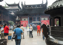 City God Temple, or Chenghuang Miao, in Shanghai. SHANGHAI, CHINA - MAY 8, 2015: Devotees light incense bundles for offering to Qin Yubo, the emperor considered Stock Photos
