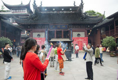 City God Temple, or Chenghuang Miao, in Shanghai. SHANGHAI, CHINA - MAY 8, 2015: Devotees light incense bundles for offering to Qin Yubo, the emperor considered Royalty Free Stock Photography