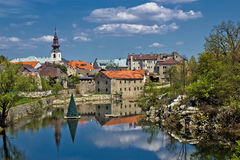 City of Gospic, Lika region. City of Gospic river reflections, Lika region, Croatia Stock Photos