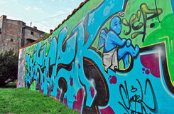 City graffiti. The wall with graffiti downtown of big city Stock Photo