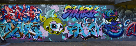 The city graffiti on the cement wall Royalty Free Stock Photography