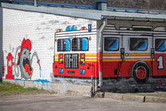 City graffiti with fire truck and fireman. Stock Photos