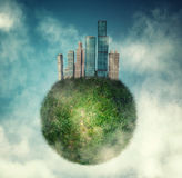City on green globe. Of earth in the sky royalty free stock image