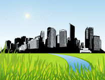 City with green grass at the front. Stock Image