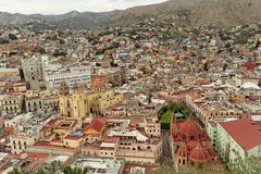 City of Guanajuato. The colorful housing of the city of Guanajuato, the yellow basilica nuestra senora de guanajuato the university in moorish style facade and a Royalty Free Stock Photo