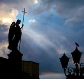 The city guard. The statue of an angel on a background of sky with ray of light Stock Photography
