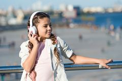 City guide and audio tour. Girl little tourist kid explore city using audio guide application. Free style of travelling. Exciting journeys through cities and stock images