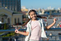 City guide and audio tour. Girl little tourist kid explore city using audio guide application. Free style of travelling. Exciting journeys through cities and stock photo