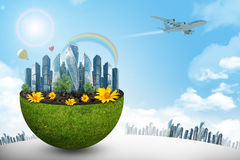 City in half green globe with flowers Stock Photos