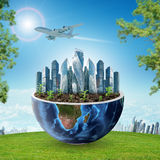 City in half planet with green grass and trees Royalty Free Stock Photography