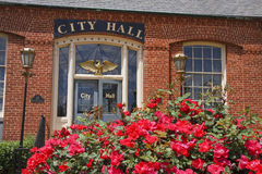 City Hall. Belmont, North Carolina City Hall with red Knock Out roses in front stock photo