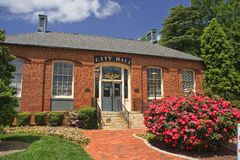 City Hall. Belmont, North Carolina City Hall with red Knock Out roses in front royalty free stock photo