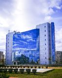 City Hall building in Ploiesti , Romania. Modern building with glass facade in Ploiesti , Romania, where the administrative offices of the city hall are located stock photo