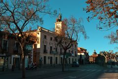City Hall on the central square of a small Spanish city. On a sunny day among the trees royalty free stock photo
