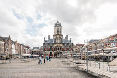 City Hall of Delft from the Square with market stalls  a cloudy Stock Photo