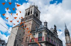 City Hall of Delft. Town Hall of Delft, Holland, with orange flags as a sign of the house Oranje Stock Photography